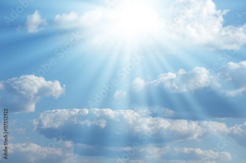 Fototapeta Bright sun shines among the white clouds