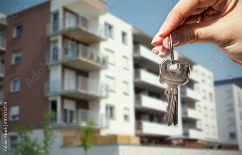 Woman hand holding keys with to house