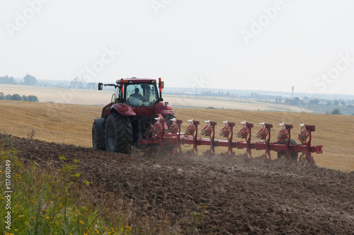 Poster Tractor with plow agriculture on arable land processes