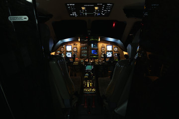 Aircraft interior, cockpit view inside turboprop plane.