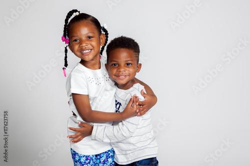 young african american siblings hugging buy photos ap images