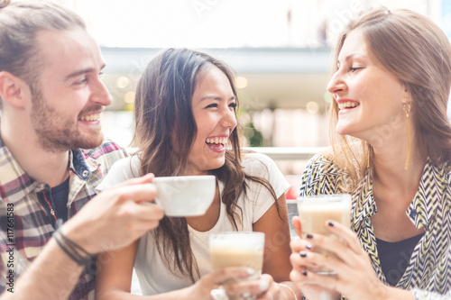 Multiracial group of friends having a coffee together Poster