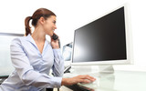 smiling woman in office at desk in front of computer screen, tal