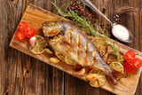 Grilled fish on the table - 117717388