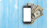 Fototapety Mobile phone with empty screen and money with credit cards on wo