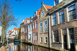 Colorful street view with traditional dutch houses, canal in downtown of popular Holland destination