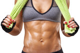 Fit woman holding a green towel, isolated on white background