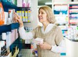 Female near counter in pharmacy