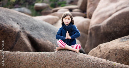 Foto op Canvas Zen spiritual kid relaxing, praying and breathing alone for yoga outdoor