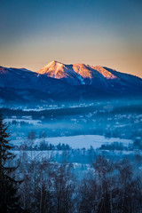 Sunrise in Zakopane with illuminated peak in winter, Tatra Mountains, Poland © shaiith