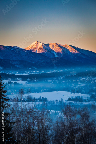 Sunrise in Zakopane with illuminated peak in winter, Tatra Mountains, Poland