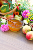 Flower honey, apples and garden flowers