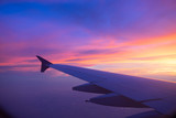 Sunset sky from the airplane window - 117779949