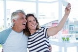 Smiling mature couple taking selfie