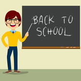 Happy teacher character standing on classroom in front of blackboard pointing at Back to School text