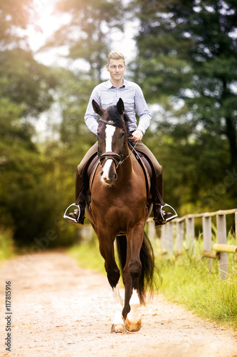 man riding a horse on the countryside