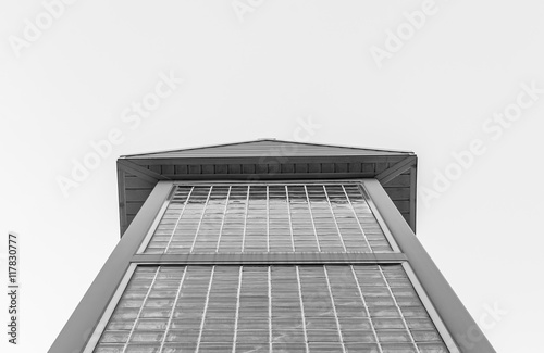 Glass brick building isolated with blue sky background. Minimal architecture glass building. Isolated architecture pyramid roof. Minimal art and design. Modern design structure. Steel. Black and white - 117830777