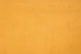 Grainy Plastered Texture of Blank Yellow Dry Wall