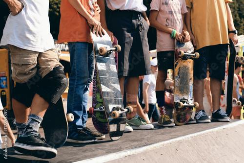 Fotobehang Skateboard Group of skaters waiting for their turn on the slide