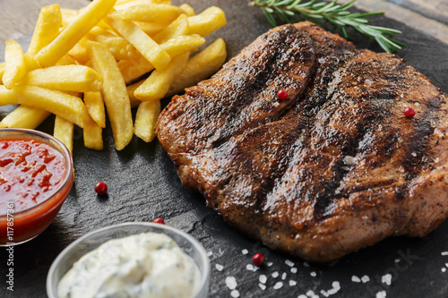 Aluminium Steakhouse Beef steak with french fries and sauce