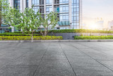 pavement front of financial building with green - 117894539