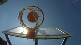 Ball falls through basketball hoop, scoring a point in streetball game