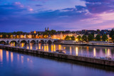 Maastricht Netherlands with 13th Century Sint Servaas bridge and Maas River around sunset
