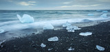 floated iceberg  on the lava beach