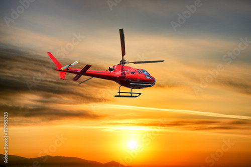 obraz PCV Helicopter Flying at sunrise