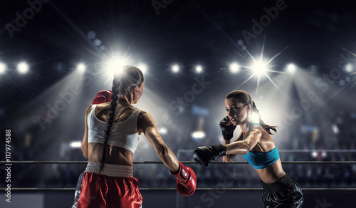 Staande foto Girls boxing in ring . Mixed media