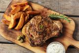 steak on the bone steak with baked potato and gravy