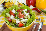 Greek salad with feta and tasty selection of vegetables.