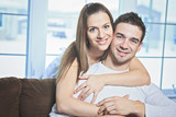 Happy couple at home relaxing in sofa