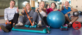 Portrait of aged men and women in top form in modern gym