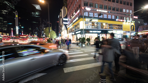 Keuken foto achterwand Seoel SEOUL, SOUTH KOREA - OCTOBER 22, 2015: Pedestrians crossing the road on zebra in big night illuminated city