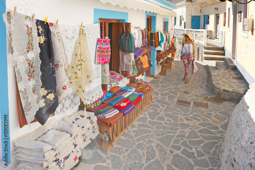 A woman in a touristic shop of Olympos in Karpathos, Greece