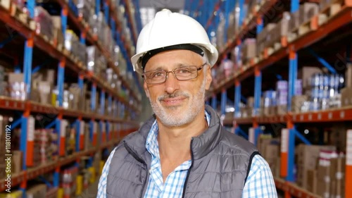 Staande foto Industrial geb. Focus on warehouse worker smiling to the camera