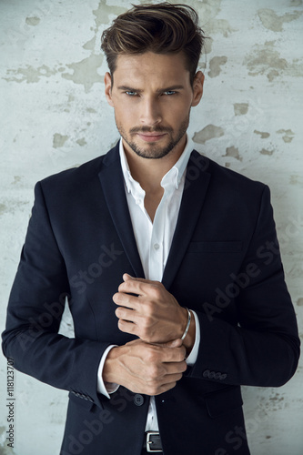 Portrait of sexy man in black suit Poster