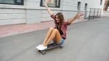 Girl riding on a skateboard