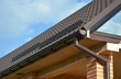 Building Modern House Construction with metal roof corner, rain gutter system
