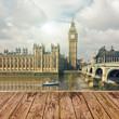 Empty wooden table over London Big Ben landmark