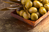 green olives in wooden dish