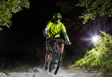 Mountain biker riding in forest stream