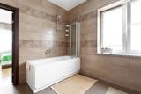 White bathtub in large bathroom