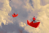 Fototapety men on origami red paper boats floating in the cloudy sky,illustration painting