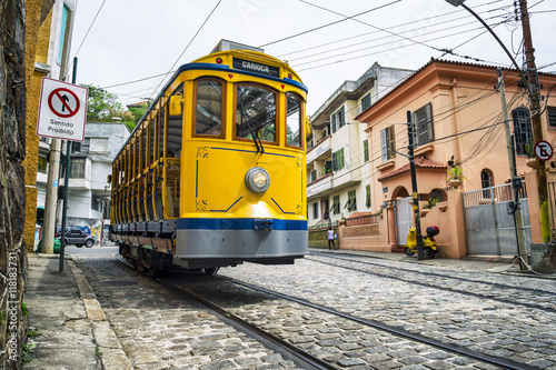 Iconic bonde tram travels along the streets of the tourist nieghborhood of Santa