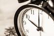 Retro vintage clock on sack closeup at 10 o'clock
