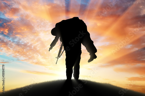 Soldier carries a wounded soldier at sunset Poster