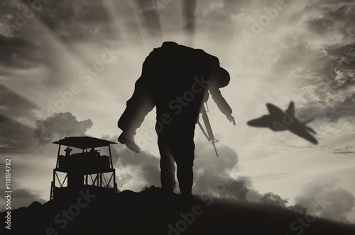 Poster Soldier carries a wounded soldier