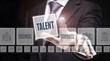 Businessman pressing an Talent concept button on a dark background